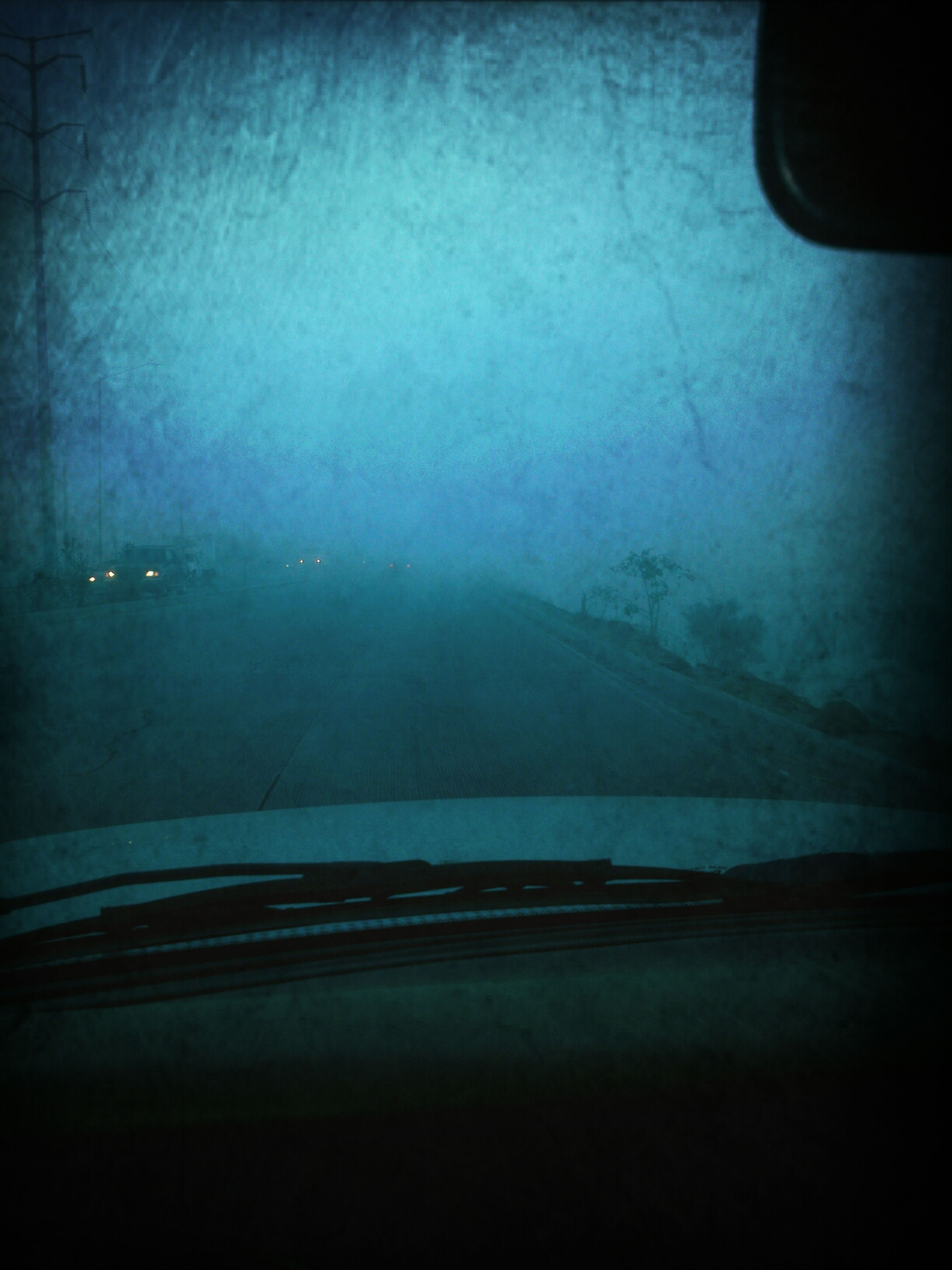 transportation, mode of transport, car, land vehicle, vehicle interior, transparent, glass - material, indoors, weather, window, road, water, car interior, copy space, reflection, no people, windshield, nature, fog, motion