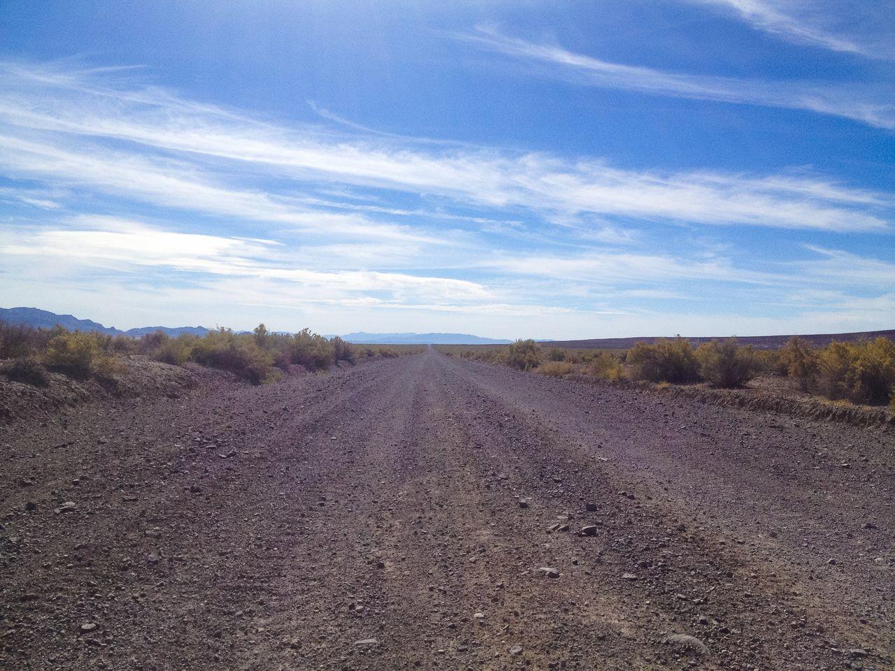 Road through the Black Rock Desert area in Northern Nevada. Arid Climate Arid Landscape Barren Black Rock Desert Blue Sky Desert Desert Landscape Desert Road Horizon Horizon Over Land Outdoors Remote Road Sagebrush Sand