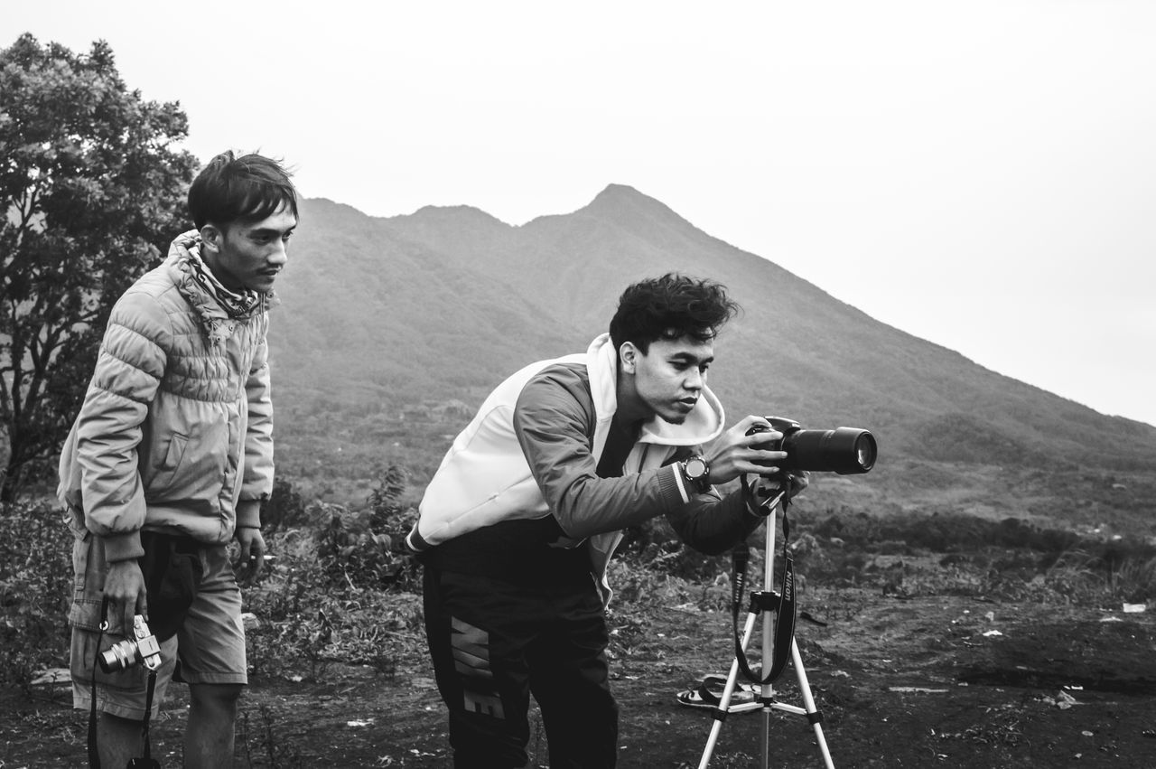 Two People Photography Themes Camera - Photographic Equipment Photographer Nature Outdoors Day Young Adult Standing Mountain People Captured Moment Taking Photos Taking Pictures Capture The Moment Nature Beauty In Nature Break The Mold First Eyeem Photo Real People EyeEm Indonesia Blackandwhite Black And White Black & White Monochrome