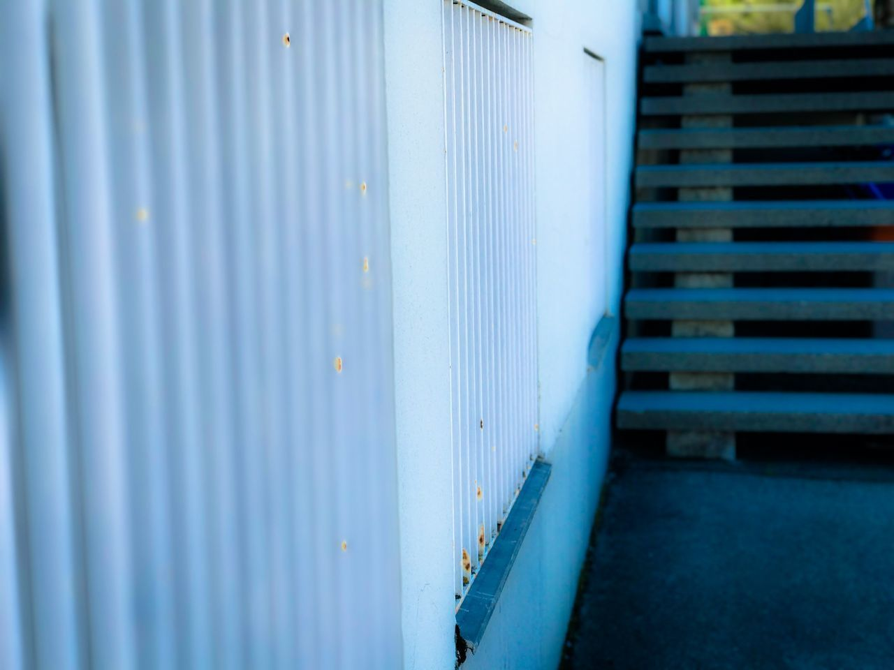 Architecture Blue Building Exterior Built Structure Cargo Container Close-up Corrugated Iron Day Door Freight Transportation Industry Loading Dock Metal No People Outdoors Parking Garage Shipping  Shutter Transportation Warehouse