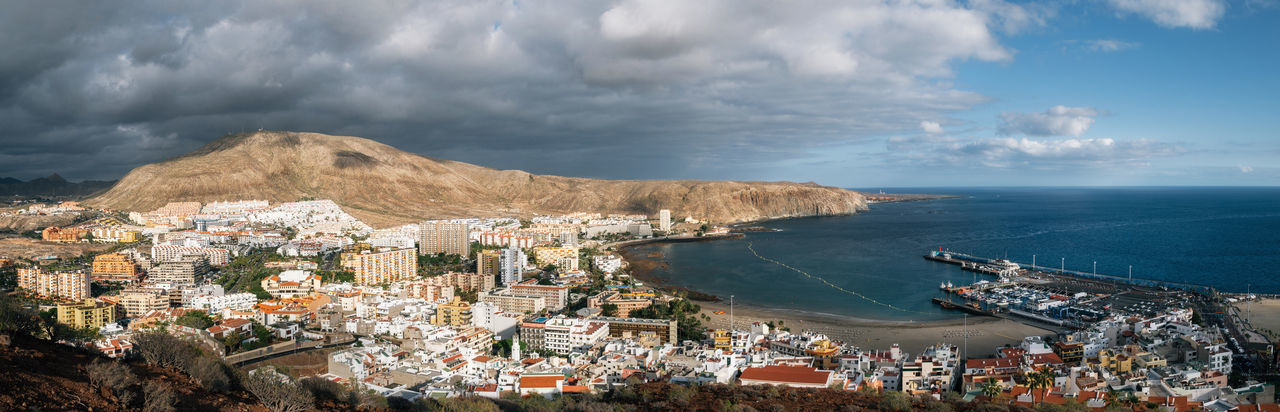 Panoramic view of Los Cristianos. Viiew from above. Canary Island, Tenerife, Spain Architecture Building Exterior Built Structure City Cityscape Cloud - Sky Day Harbor Horizon Over Water Los Cristianos Mountain Nature Outdoors Panoramic Resort Scenics Sea Sky Tenerife Town Water