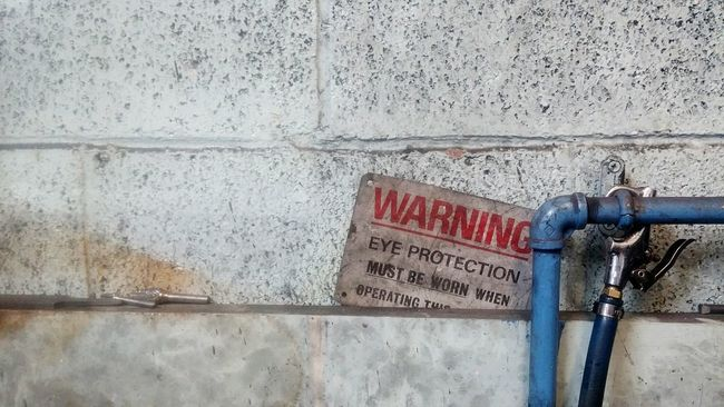 Important Information Dust Muck Dirty Red Writing Warning No People EyeEm Gallery Warning Sign Eye Protection Danger Dangerous Painted Brick Brick Wall Air Pipe