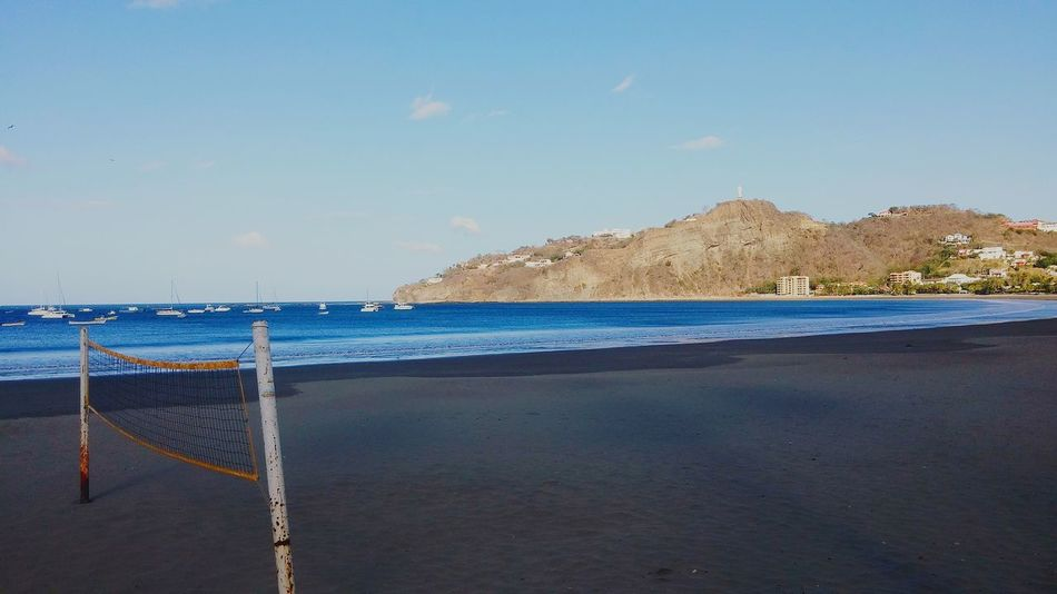 Nicaragua, San Juan del Sur (2016) Nicaragua San Juan Del Sur , Nicaragua Beach Pacific Ocean Ocean Water Sand Outdoors Day Nature No People Sky Tourism The Week On EyeEem Boats Vessels Travel Photography EyeEmBestPics Horizon Over Water Mountain EyeEmNewHere Blue Water Volleyball Volleyball Net Landscape