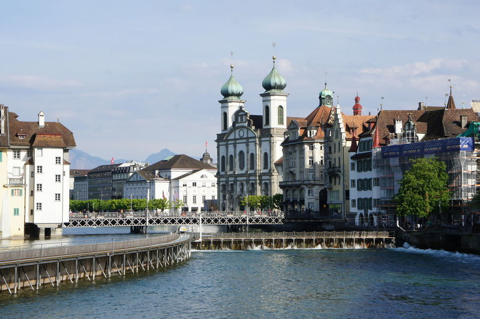 View of the Jesuit Church in Lucerne Architecture Building Exterior Built Structure Castle Church City Day Dome History No People Outdoors Place Of Worship Religion Reuss River River Sky Spirituality Town Travel Destinations Water Waterfront