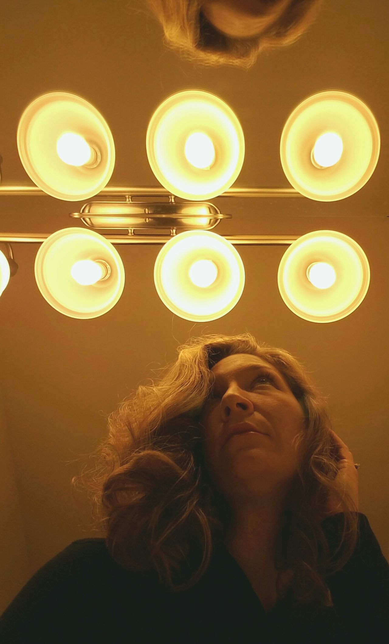 Light Bulb One Person One Woman Only People Illuminated Human Hair Electricity  Hair Glow Mirror Reflecting Lighting Lighting Up Light Fixture Woman Shine