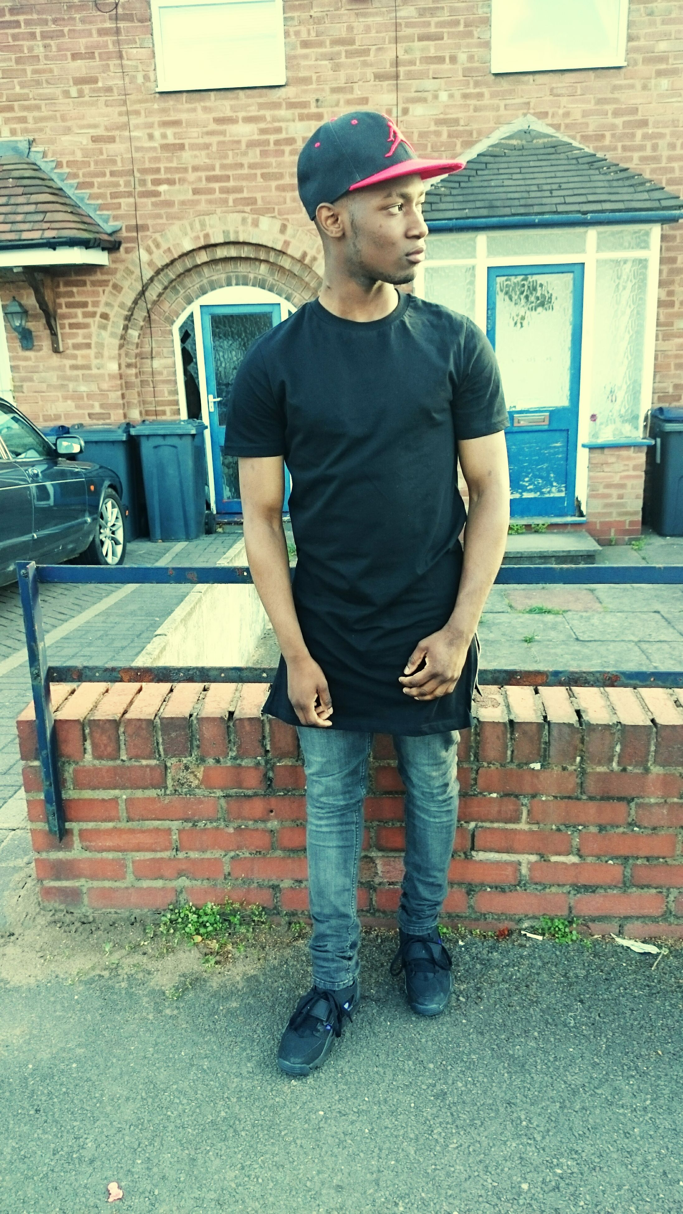 full length, building exterior, casual clothing, built structure, architecture, lifestyles, person, young adult, standing, leisure activity, front view, young men, side view, sunglasses, hands in pockets, three quarter length, house, holding