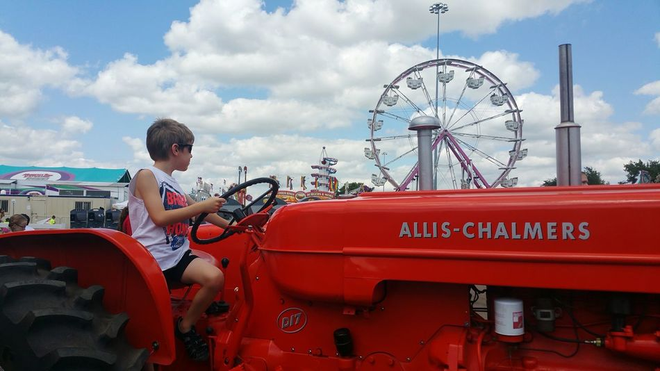 Fair time Hello World Check This Out Hanging Out Taking Photos Relaxing Enjoying Life Fair Fairground Fairtime Fair Time Sioux Empire Fair Sioux Falls Sioux Falls, South Dakota Making Memories Tractor Red Tractor Ferris Wheel Ferriswheel Fair Rides Clouds Clouds And Sky