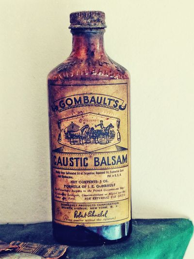 Old-fashioned Antique Text The Past Ancient White Background No People Indoors  Shadows & Lights Pioneerlife Farm Life Country Life Vintage Close-up Green Color Country Kitchen Farm Photos Oldtimes Old Time Photos Old Time Tonic Bottle Antique Bottle Antique Close Up Old Lable Brown Glass