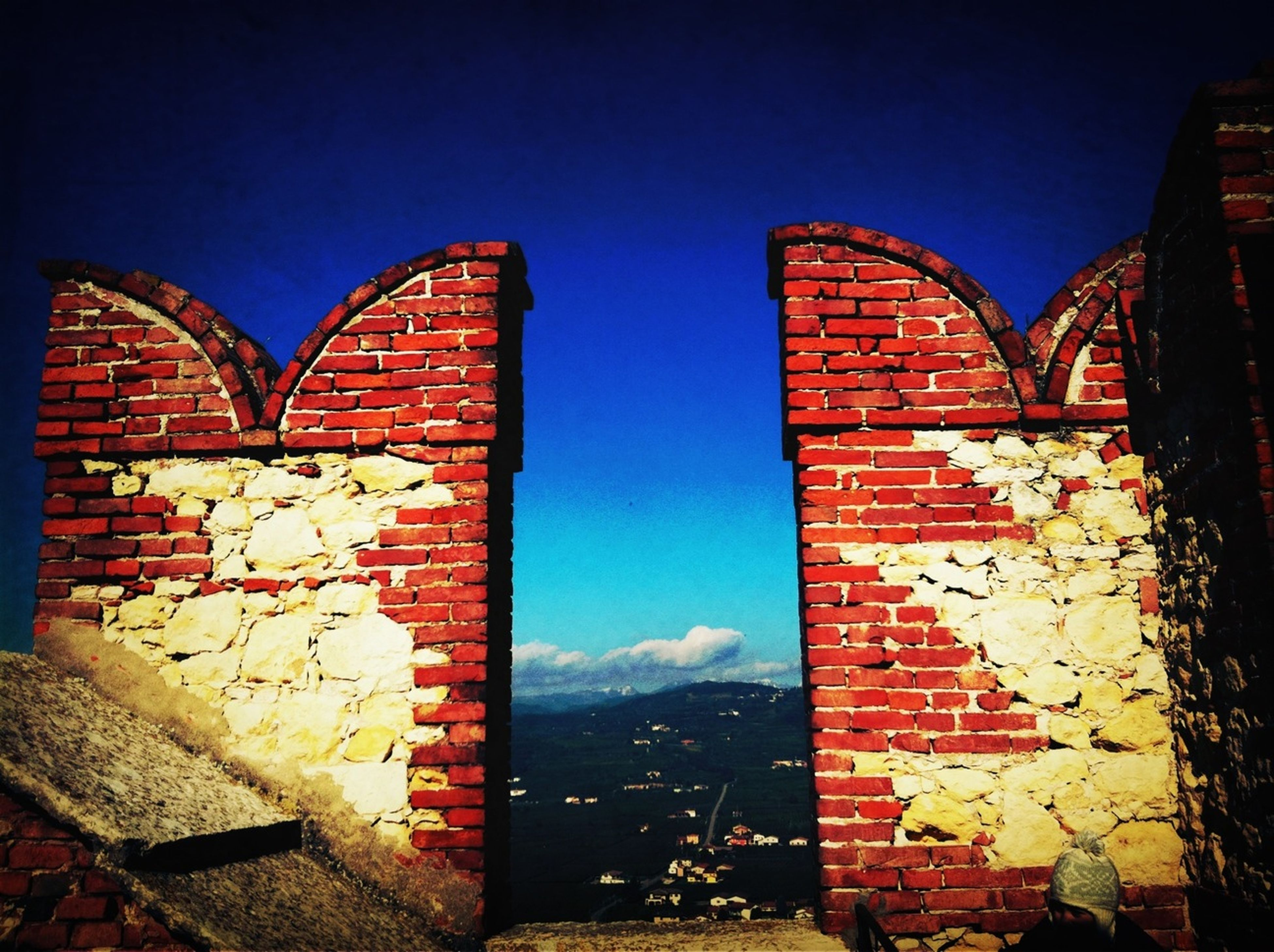 architecture, built structure, building exterior, brick wall, blue, wall - building feature, window, clear sky, house, auto post production filter, sky, wall, stone wall, day, residential structure, no people, outdoors, low angle view, sunlight, building