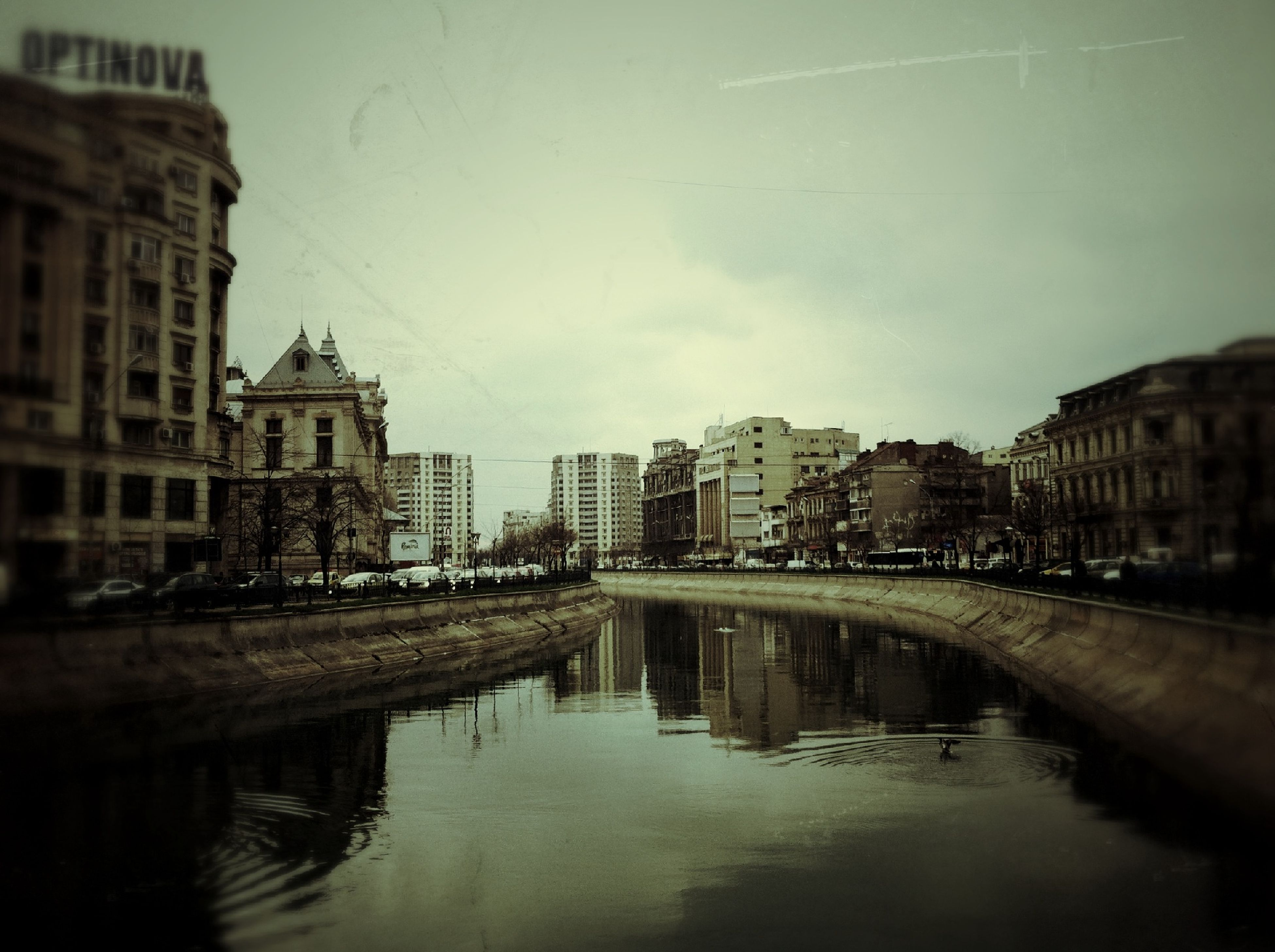 architecture, building exterior, built structure, water, waterfront, reflection, canal, sky, city, river, building, residential building, residential structure, residential district, outdoors, house, no people, connection, cloud - sky, day
