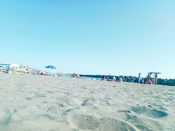 Beach Sand Large Group Of People Sky Blue Clear Sky Day Outdoors People Nature Sea Adult Crowd Water Adults Only Only Men