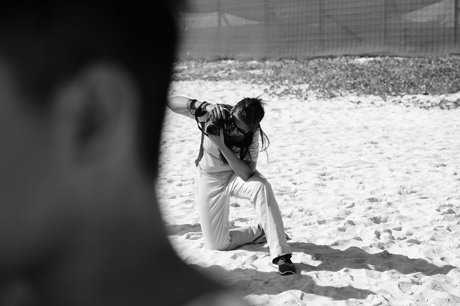 beach photographer in action Adult Back Can Child Childhood Children Only Day Mexico Monochrome Ocean One Girl Only One Person Outdoors People Photographer Pose Rear View Subject