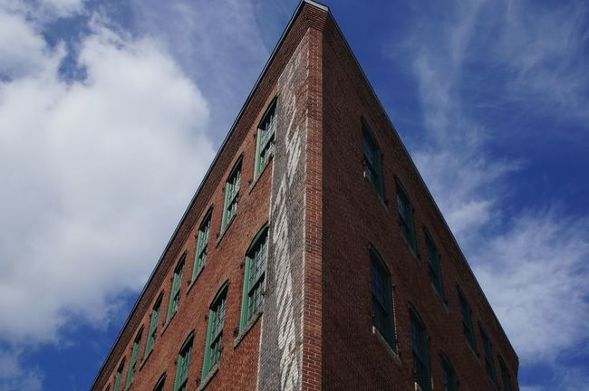Architectural Feature Architecture Blue Brick Building Brick Wall Building Built Structure City Cloud Cloud - Sky Cloudy Façade High Section Low Angle View Sky Tall - High
