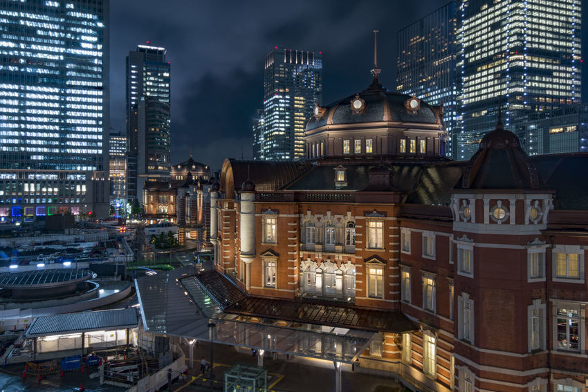 Tokyo Tower at night with skyscrapers in the background Architecture Building Exterior Business District Business Finance And Industry Central Park City City Life Cityscape Downtown District Historic Architecture Illuminated Japan Modern Night No People Outdoors Railway Station Shinkansen Sky Skyscraper Tokyo Tokyo Station Train Station Travel Destinations Urban Skyline