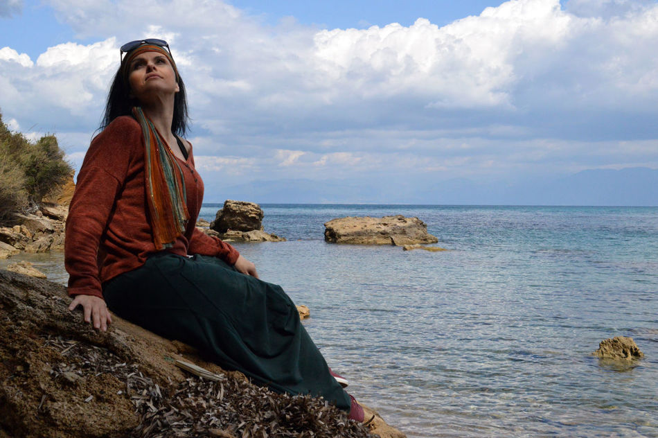 Beauty In Nature Brunette Cloud - Sky Clouds And Sky Horizon Over Water Leisure Activity Rock - Object Sea Sitting On A Rock Sitting On Rocks Travel Photography Traveling Woman Woman Staring Women Around The World