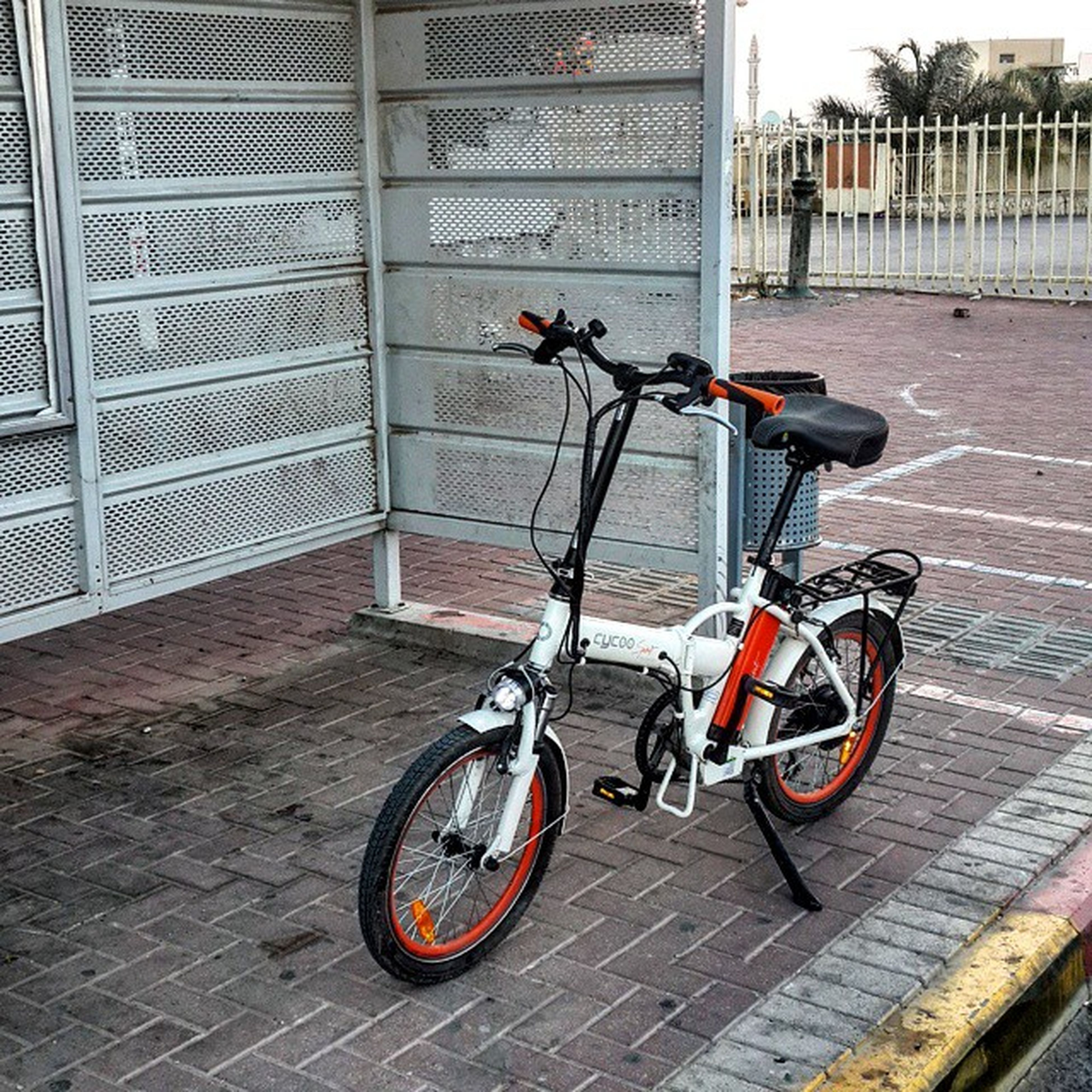 bicycle, transportation, land vehicle, mode of transport, stationary, parking, parked, building exterior, architecture, street, built structure, sidewalk, city, day, cycle, wall - building feature, no people, outdoors, paving stone, cobblestone