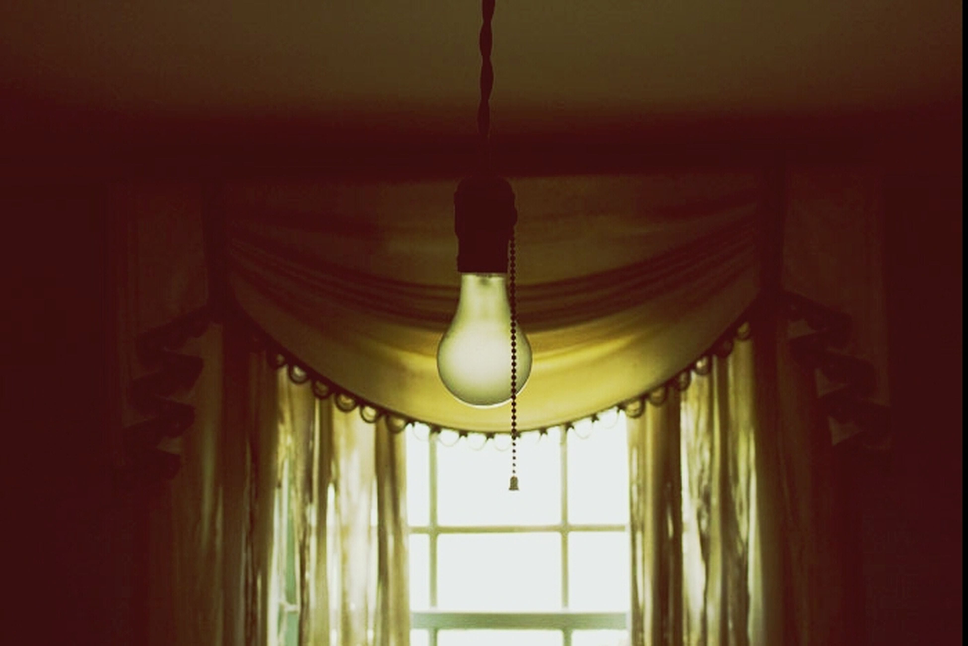 indoors, illuminated, ceiling, lighting equipment, hanging, home interior, curtain, architecture, window, electric lamp, built structure, house, door, chandelier, lamp, wall - building feature, decoration, no people, light - natural phenomenon, electric light