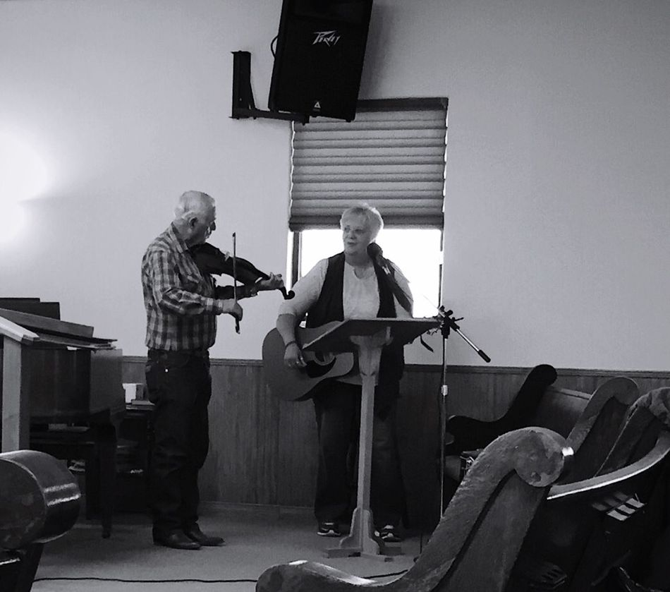 """""""The Fiddler and The Guitar Player"""" An unusual duo performs a traditional gospel song using the classic instrument's of fiddle and guitar. Fiddle Fiddler Guitar Guitarist Gospel Music Duo Music Country Living Smalltown Black And White Blackandwhite Blackandwhite Photography"""