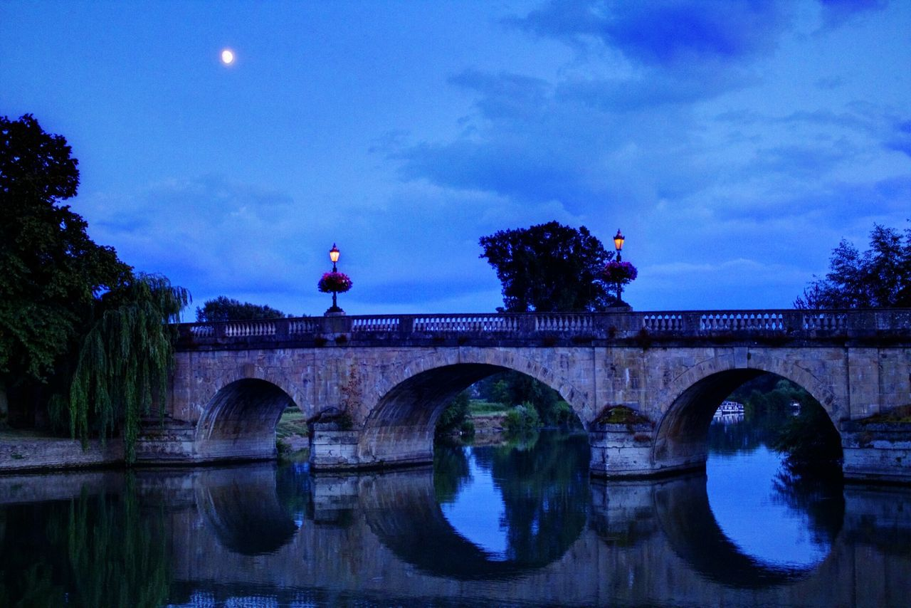 connection, bridge - man made structure, architecture, sky, reflection, water, built structure, cloud - sky, arch, outdoors, no people, nature, day, tree