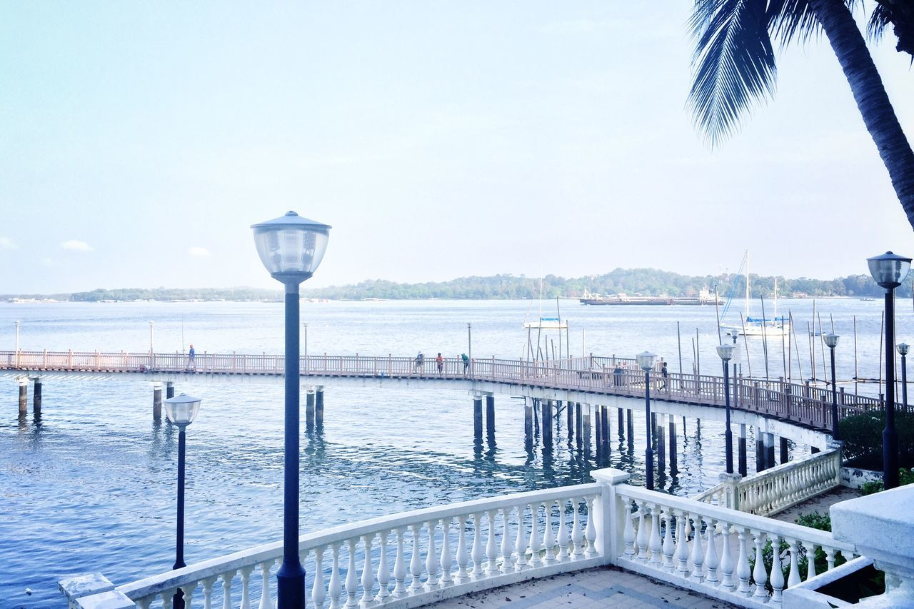 Sea Water Railing Sky Scenics Nature No People Clear Sky Day Tree Horizon Over Water Outdoors Beauty In Nature Seaside