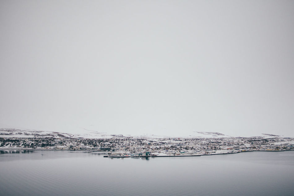 Across The Water Akureyri Beauty In Nature Cold Temperature Day Iceland Landscape Nature No People Outdoors Scenics Sea Sky Snow Town Tranquil Scene Tranquility Travel Water Waterfront Winter