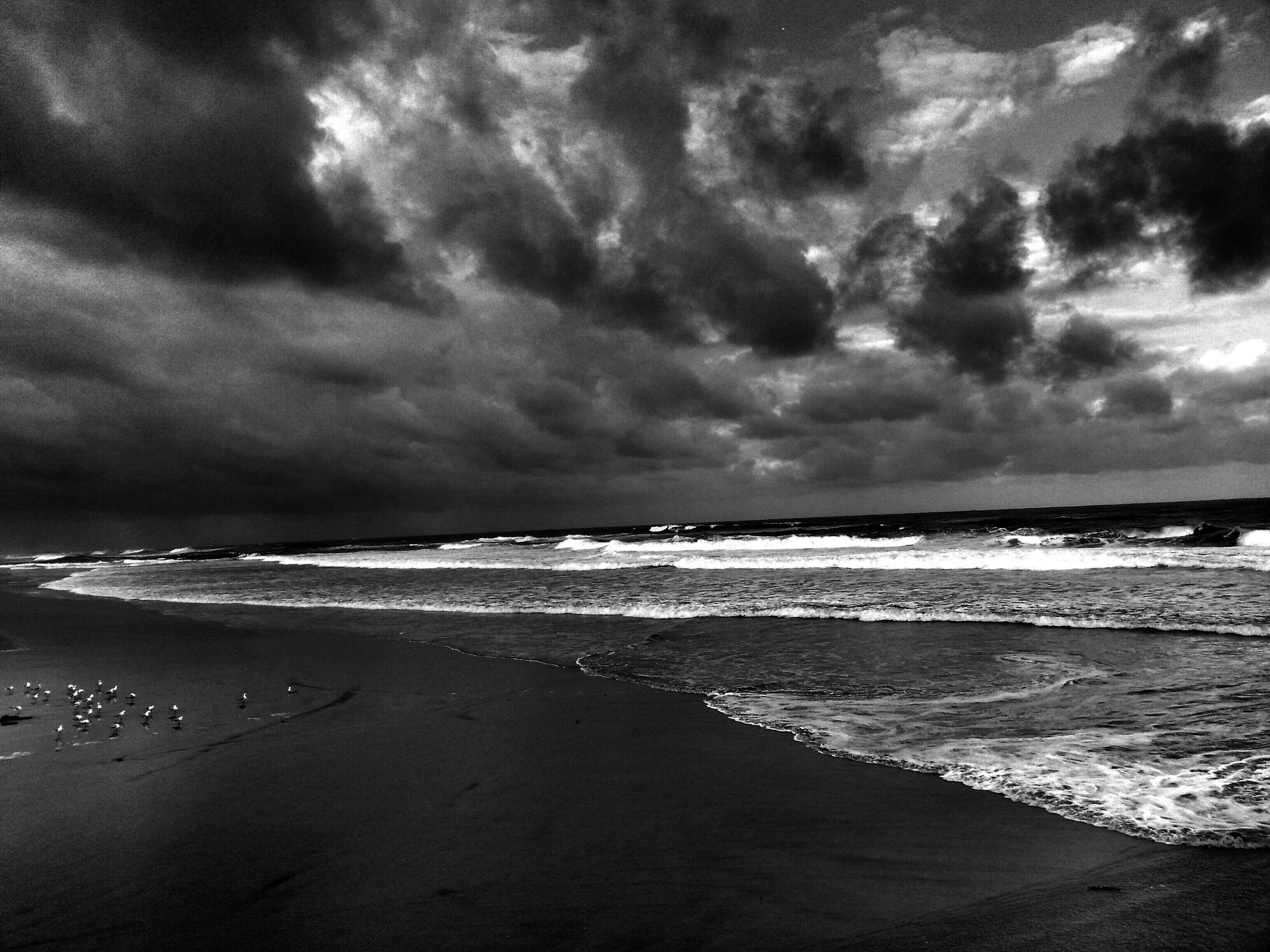 sea, beach, horizon over water, shore, water, sky, sand, scenics, beauty in nature, tranquil scene, cloud - sky, tranquility, wave, cloudy, nature, surf, coastline, idyllic, cloud, overcast