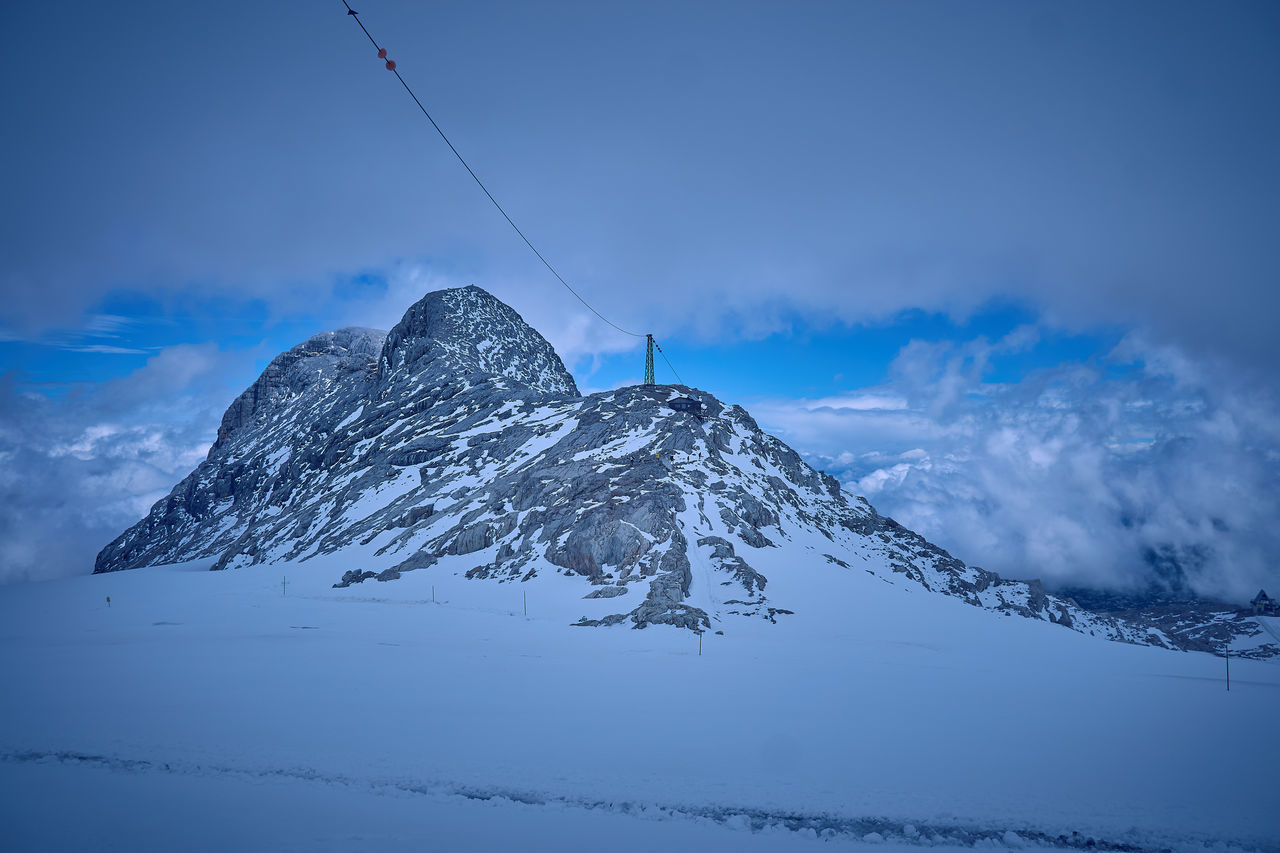 Dachstein Dachstein Gletscher Steiermark,Austria Beauty In Nature Blue Cable Cloud - Sky Cold Temperature Dachsteingletscher  Day Landscape Mountain Mountain Range Nature No People Outdoors Scenics Sky Snow Snowcapped Mountain Tranquil Scene Tranquility Weather Winter The Week On EyeEm