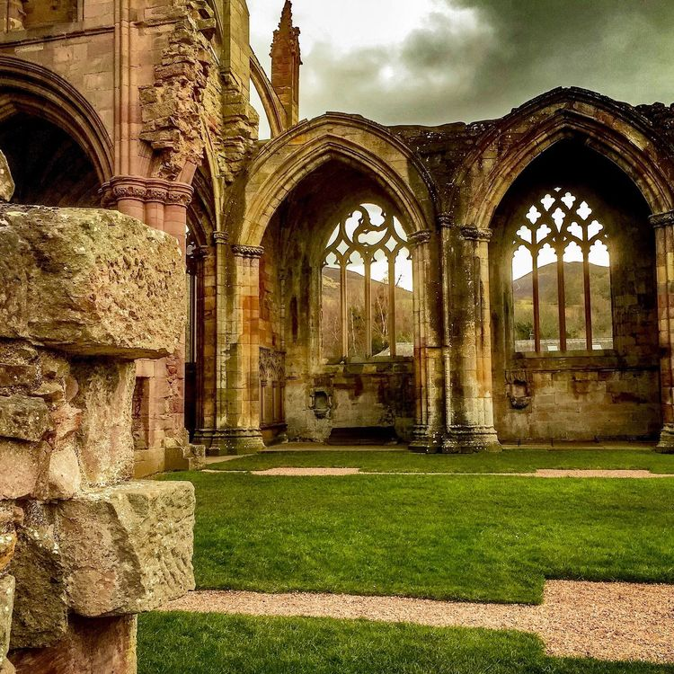 Architecture Built Structure Building Exterior Arch History Sky Grass Cloud - Sky Outdoors Cloud Day Entrance Column The Past Façade Architectural Column Damaged Architectural Feature Medieval Past Melrose Abbey