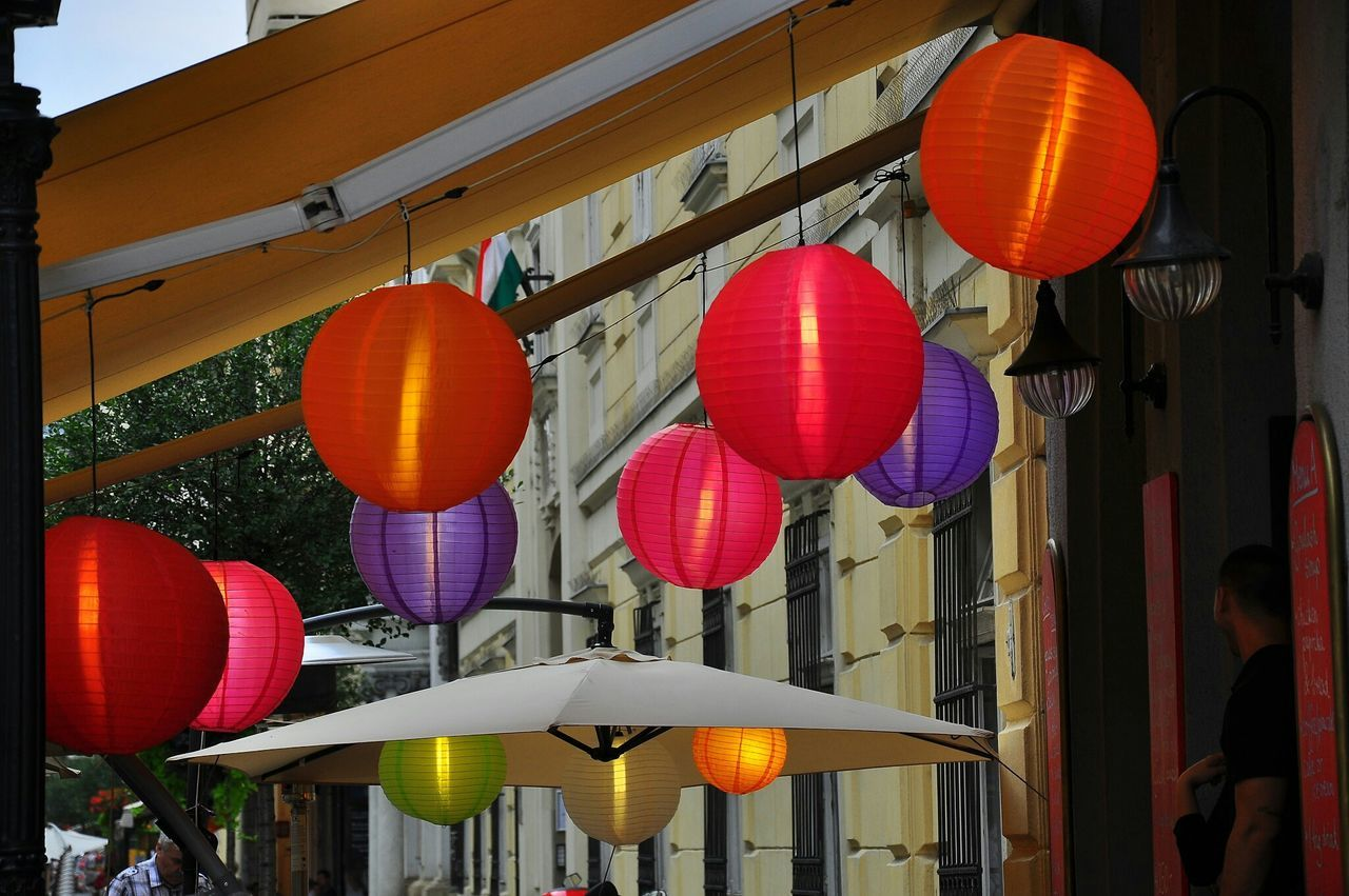 lantern, chinese lantern, hanging, lighting equipment, orange color, chinese lantern festival, low angle view, paper lantern, celebration, red, built structure, cultures, architecture, illuminated, outdoors, building exterior, traditional festival, chinese new year, no people, day, city