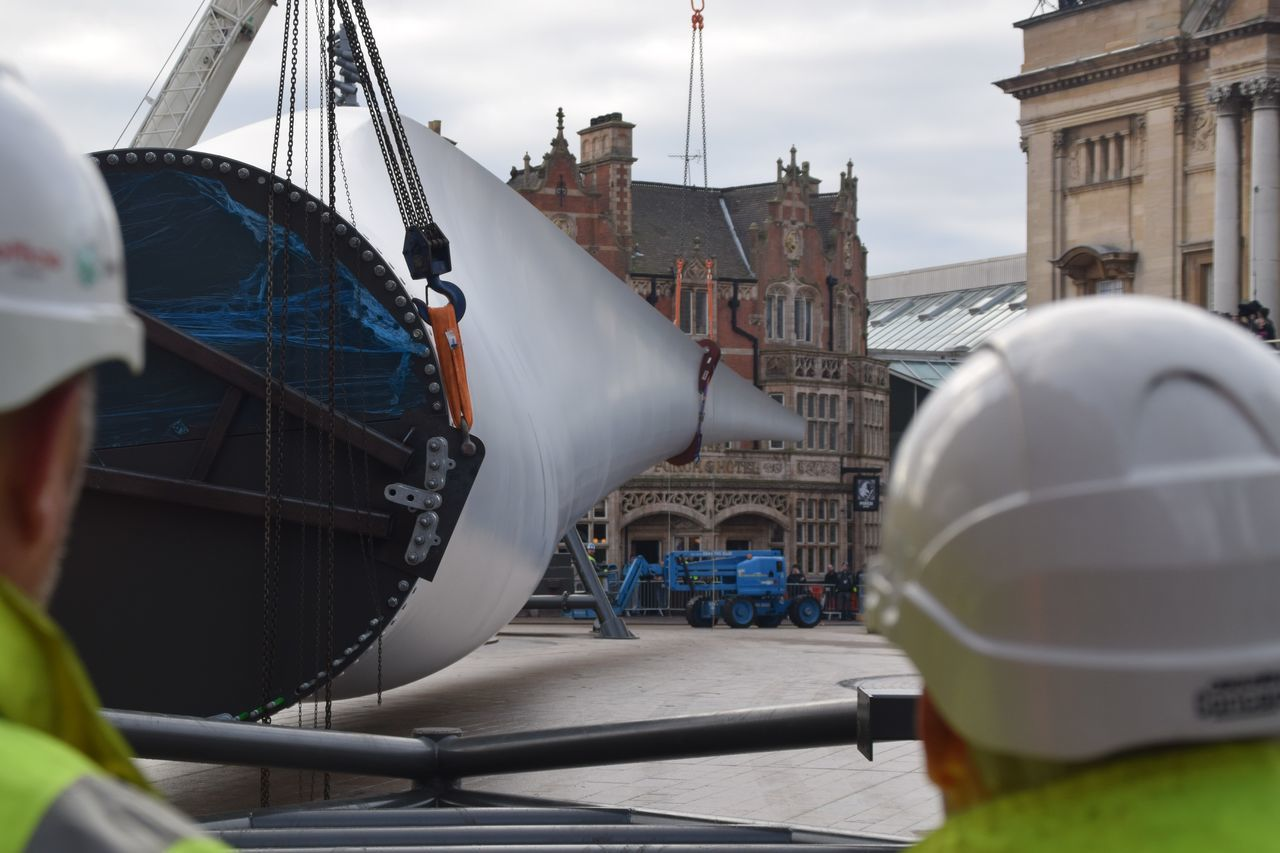 Siemens wind turbine blade is lifted into position in Hull's Queen Victoria Square (08/01/2017) during Hull 2017 City Of Culture Adult Adults Only Architecture Cloud - Sky Day Gondola - Traditional Boat Hull Hull 2017 Hull City Of Culture 2017 Hull2017 One Man Only Only Men Outdoors People Siemens  Sky Workers