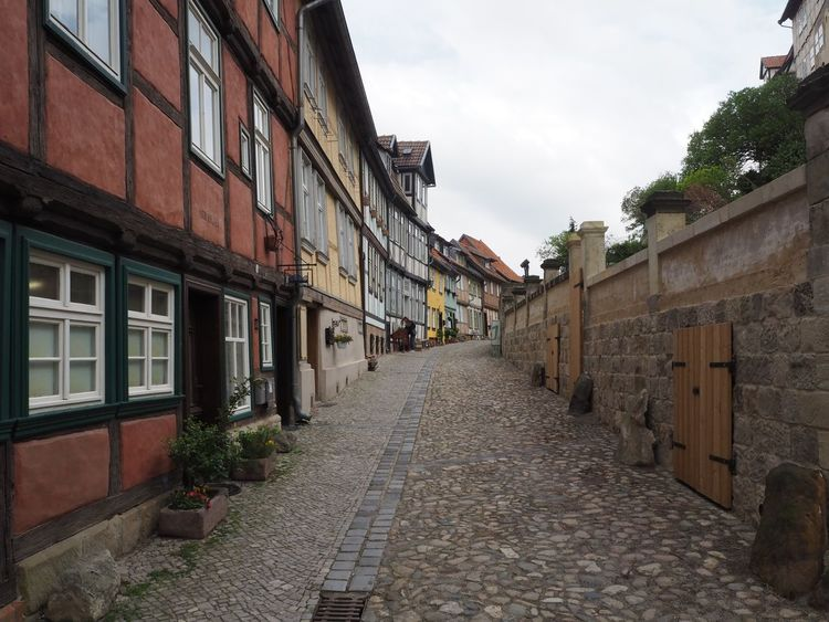 Traditional half timbered buildings in the medieval town Quedlinburg, Germany Architecture Building Exterior Built Structure Cobbled Streets Cobblestone Streets Day Germany Half Timbered Heritage Building Historic Architecture History Medieval Middle Ages No People Outdoors Quedlinburg Residential Building Saxony Anhalt Sky Spring Stone Wall The Way Forward Traditional Building Vanishing Point Window