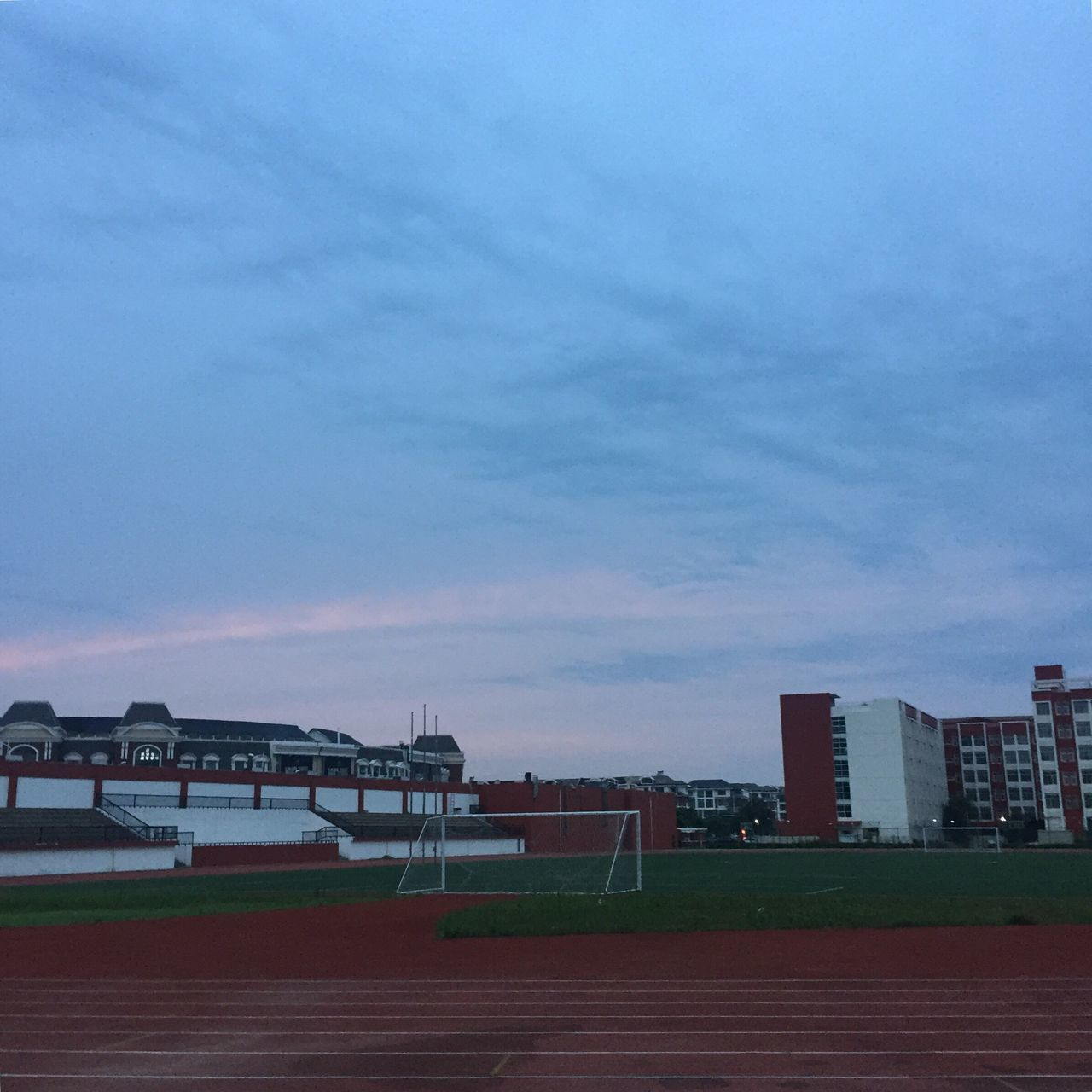 sky, sport, architecture, built structure, no people, outdoors, running track, building exterior, stadium, city, nature, day