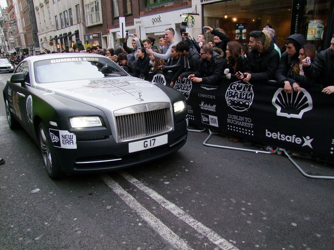 Black & Grey Rolls Royce 46 at Stage Finish Gumball 3000 Bentley Black And Grey Colour Car City City Street Composition Full Frame Fun GB Gumball3000 Land Vehicle Large Crowd Logos London Mixed Age Range Mode Of Transport Moving Outdoor Photography Petrolheads Rall Car Road Rolls Royce Spectators Sporting Event Urban