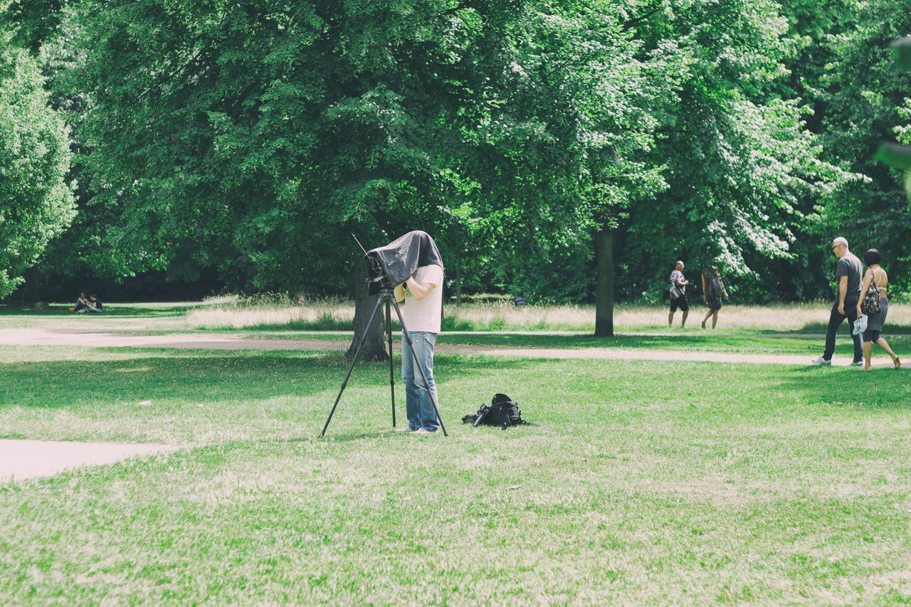 Who, What and Why? Camera - Photographic Equipment Curiosity EyeEm LOST IN London EyeEm Selects Field Grass Green Color Growth Hyde Park London London Lifestyle Londonlife Nature Outdoors Park People People And Places People Photography People Watching Peoplephotography Photographer Real People Tree
