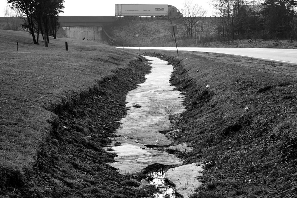 melting snow by the roadside Architecture Bridge Building Exterior Built Structure Day Ditching Class Melancholic Landscapes Melting Monochrome Nature No People Outdoors Road Shoulder The Way Forward Tree Truck