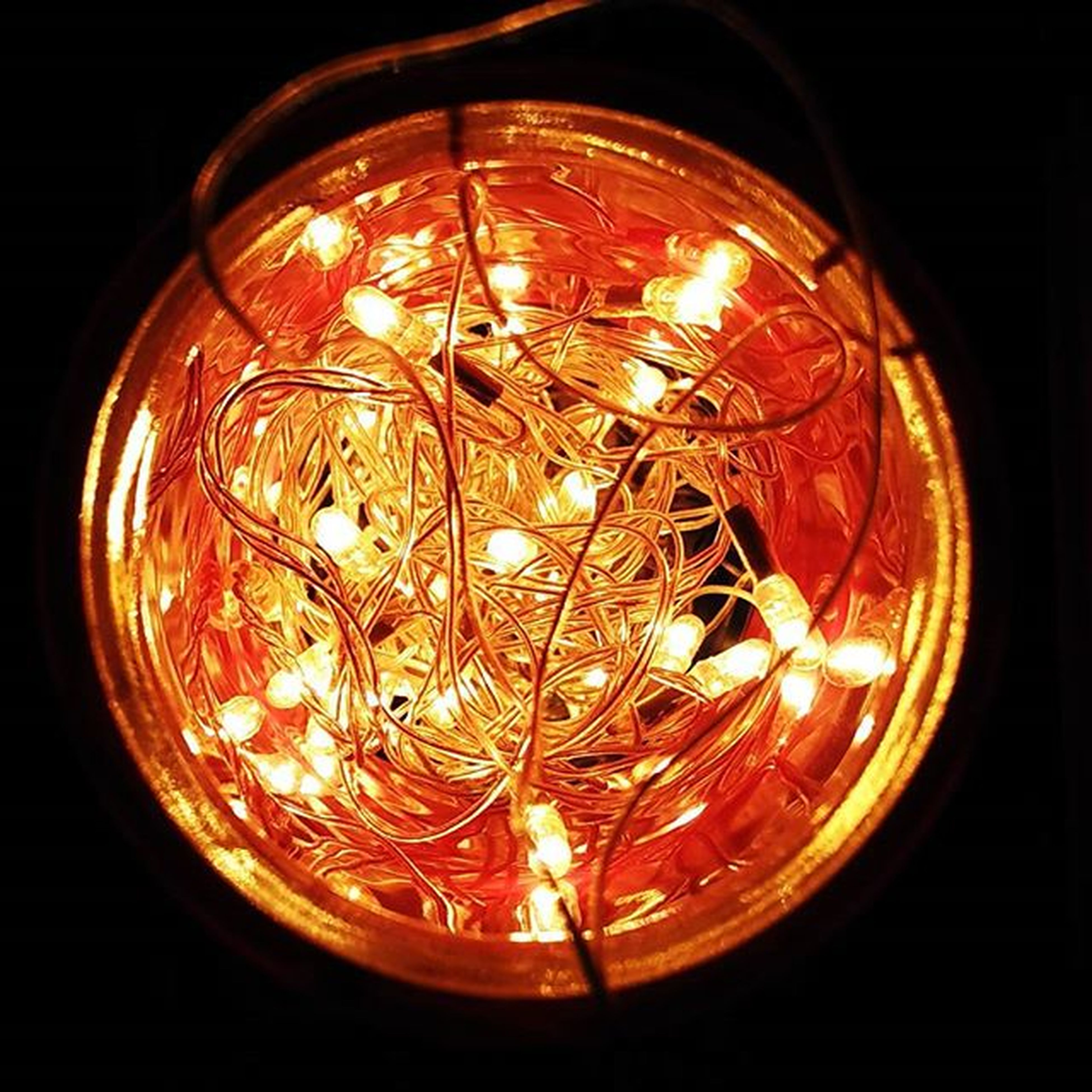 illuminated, night, glass - material, lighting equipment, low angle view, indoors, transparent, circle, glowing, dark, no people, decoration, pattern, close-up, electricity, reflection, geometric shape, window, religion, hanging