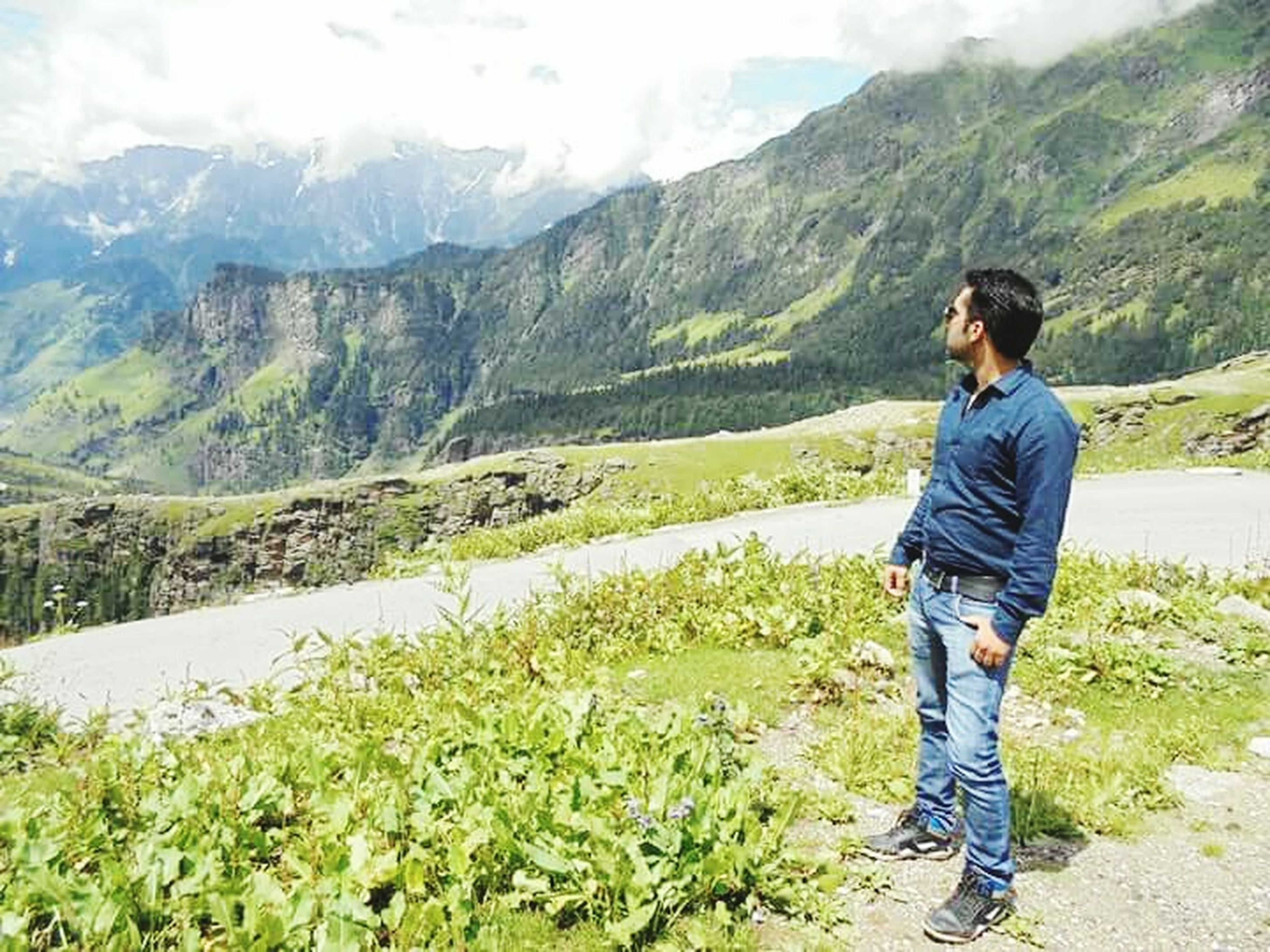 mountain, lifestyles, leisure activity, casual clothing, mountain range, standing, landscape, young adult, hiking, full length, tranquil scene, beauty in nature, tranquility, scenics, nature, young men, men, three quarter length