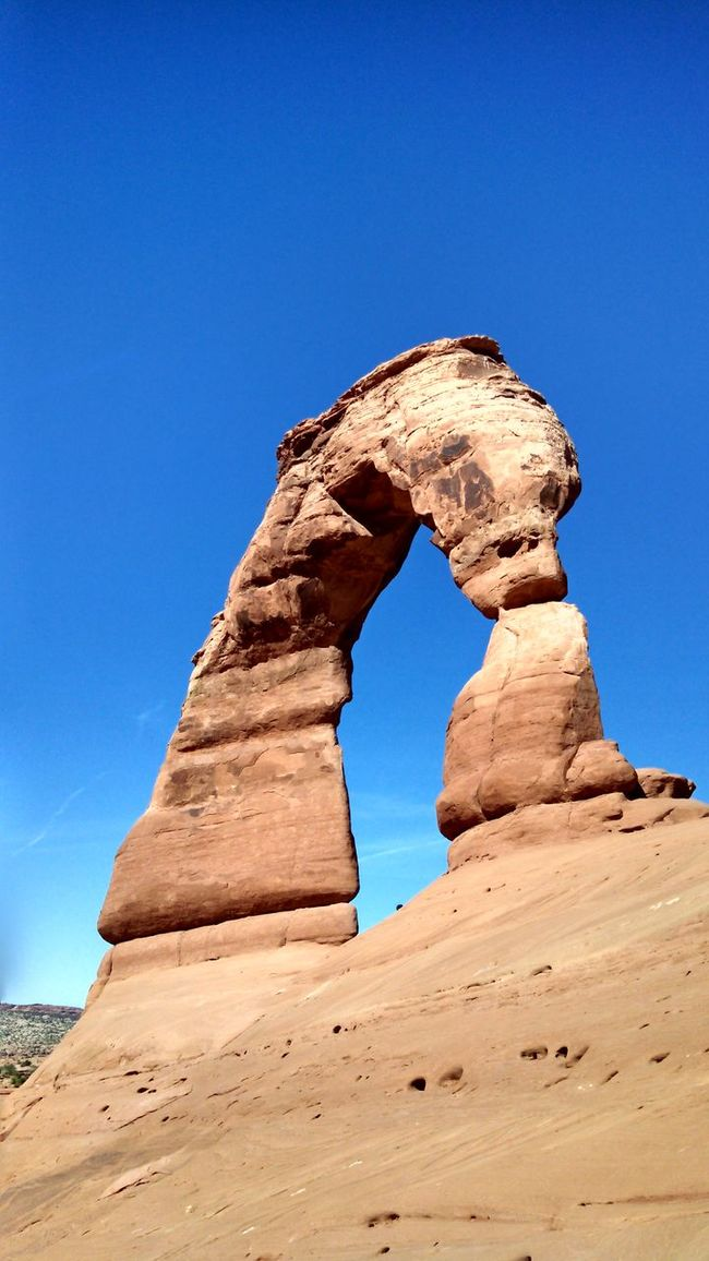 #arches #nationalpark #redrock #Utah Arid Climate Beauty In Nature Blue Clear Sky Copy Space Day Desert Eroded Geology Low Angle View Nature No People Physical Geography Rock - Object Rock Formation Scenics Sky Sunlight Tranquil Scene Tranquility