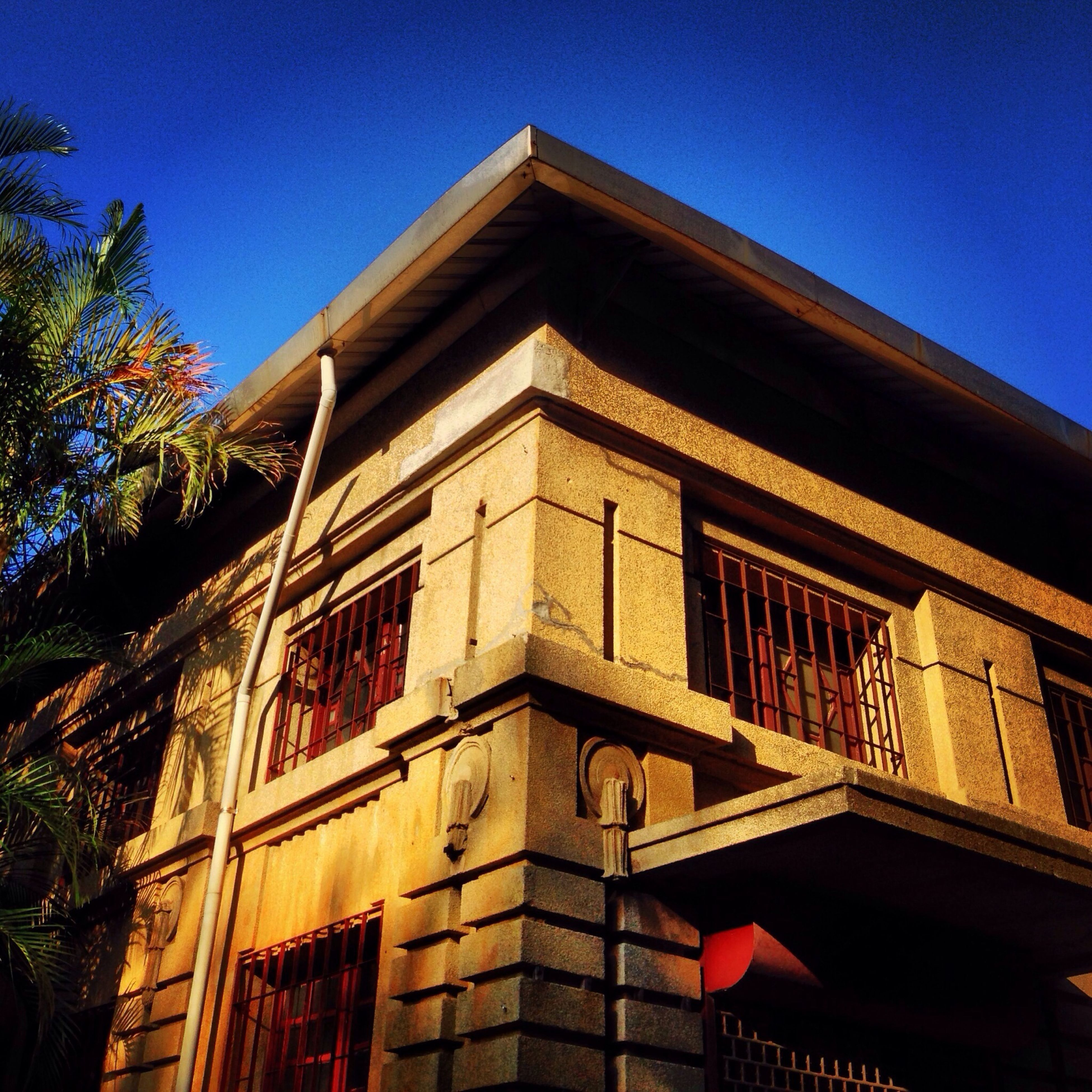 building exterior, architecture, built structure, low angle view, clear sky, blue, residential structure, residential building, window, house, tree, building, sunlight, outdoors, day, no people, sky, exterior, city, balcony