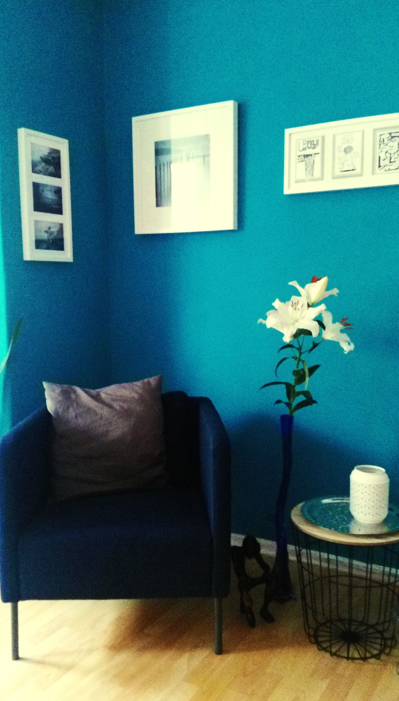 The Secret Spaces Indoors  Vase Wall - Building Feature Flower Home Interior Home Showcase Interior Chair Living Room Armchair Table No People Furniture Home Improvement Side Table Day Urban Lifestyle White Flower Lilies Lily Style Fleur De Lis Blue Background Beauty In Ordinary Things Iris - Plant Lily Flower