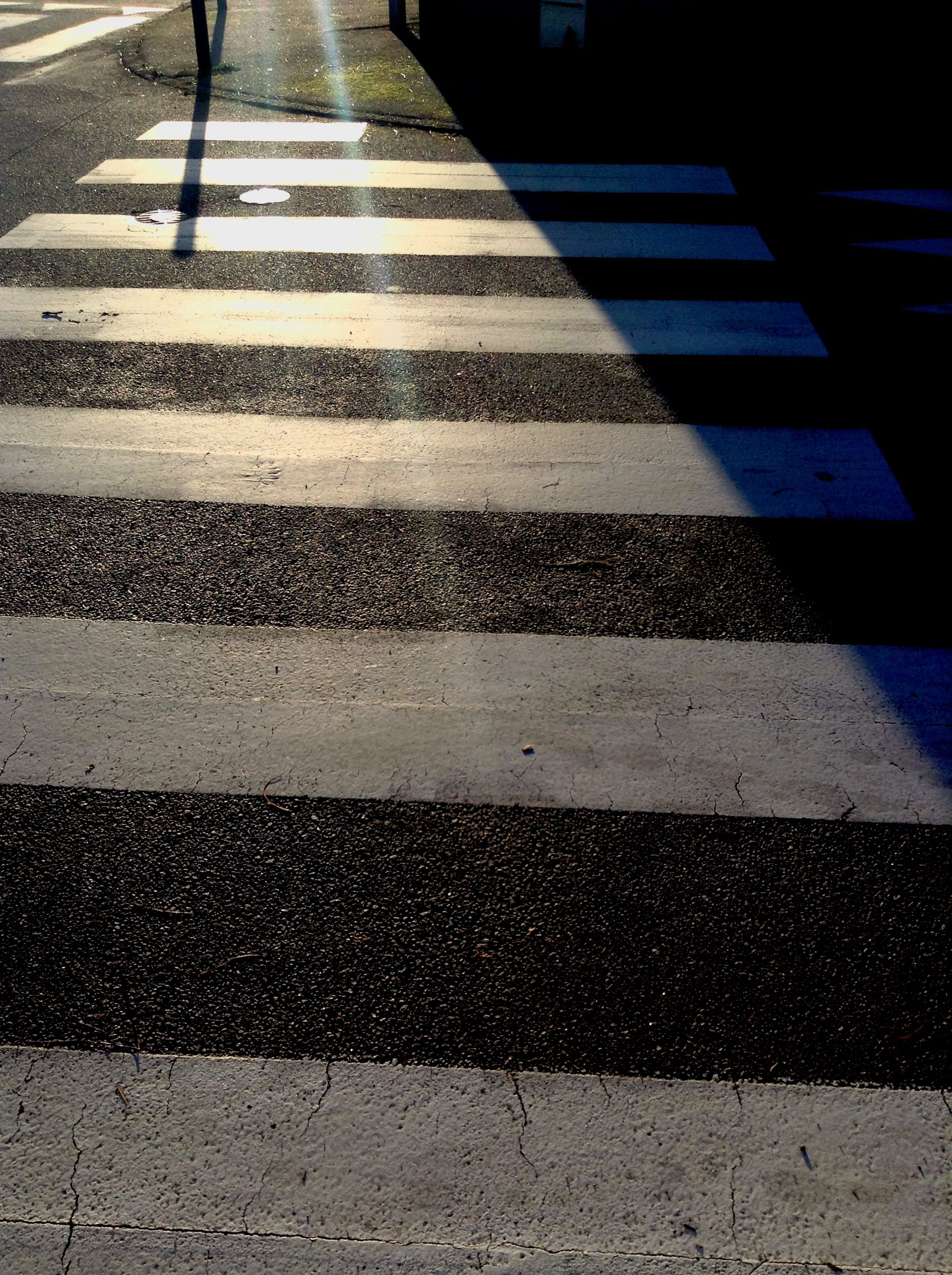 transportation, road marking, asphalt, street, the way forward, road, high angle view, zebra crossing, diminishing perspective, shadow, sunlight, vanishing point, day, outdoors, sidewalk, surface level, no people, crosswalk, steps, pattern