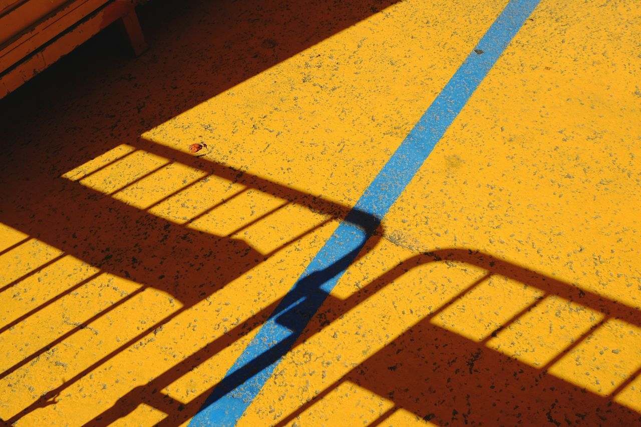 Yellow High Angle View Sunlight Shadow Outdoors No People Day Close-up Blue Illuminated Light Architecture Light And Shadow Built Structure