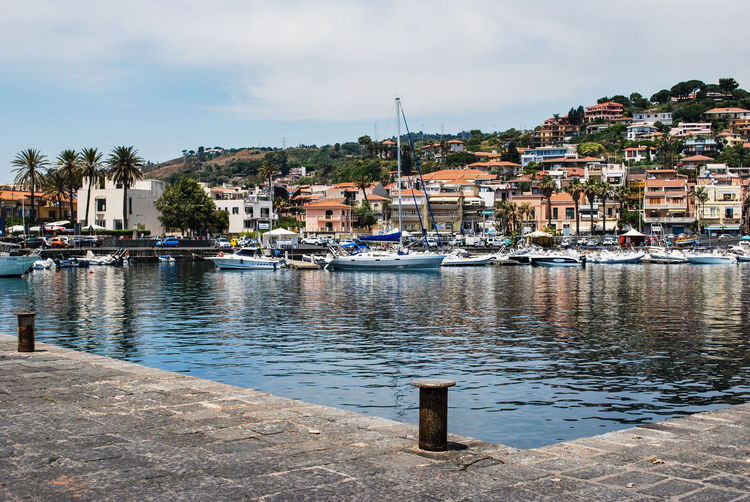 Acitrezza. Sicily. Water Harbor Pier Sea Building Exterior Nautical Vessel House Town Yacht Outdoors Waterfront Marina Reflection No People Summer Cloud - Sky Residential Building Vacations Sky Tourist Attraction  Food And Drink Ionian Coast Acitrezza  Sicily Ionian Sea