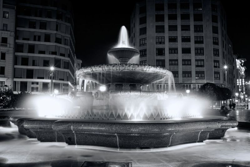 Water fantasy Fountain in the city Bnw_friday_eyeemchallenge Water_collection Water Fountain Night Photography Night Lights Monochrome Artistic Expression Night View Creative Light And Shadow Urban Geometry Urban Photography Ladyphotographerofthemonth Light And Shadows Perspective Selectivefocus From My Point Of View Selective Focus Outdoors No People Getting Inspired Eye4photography  Street Photography Architecture Water Reflections Christmas Decorations