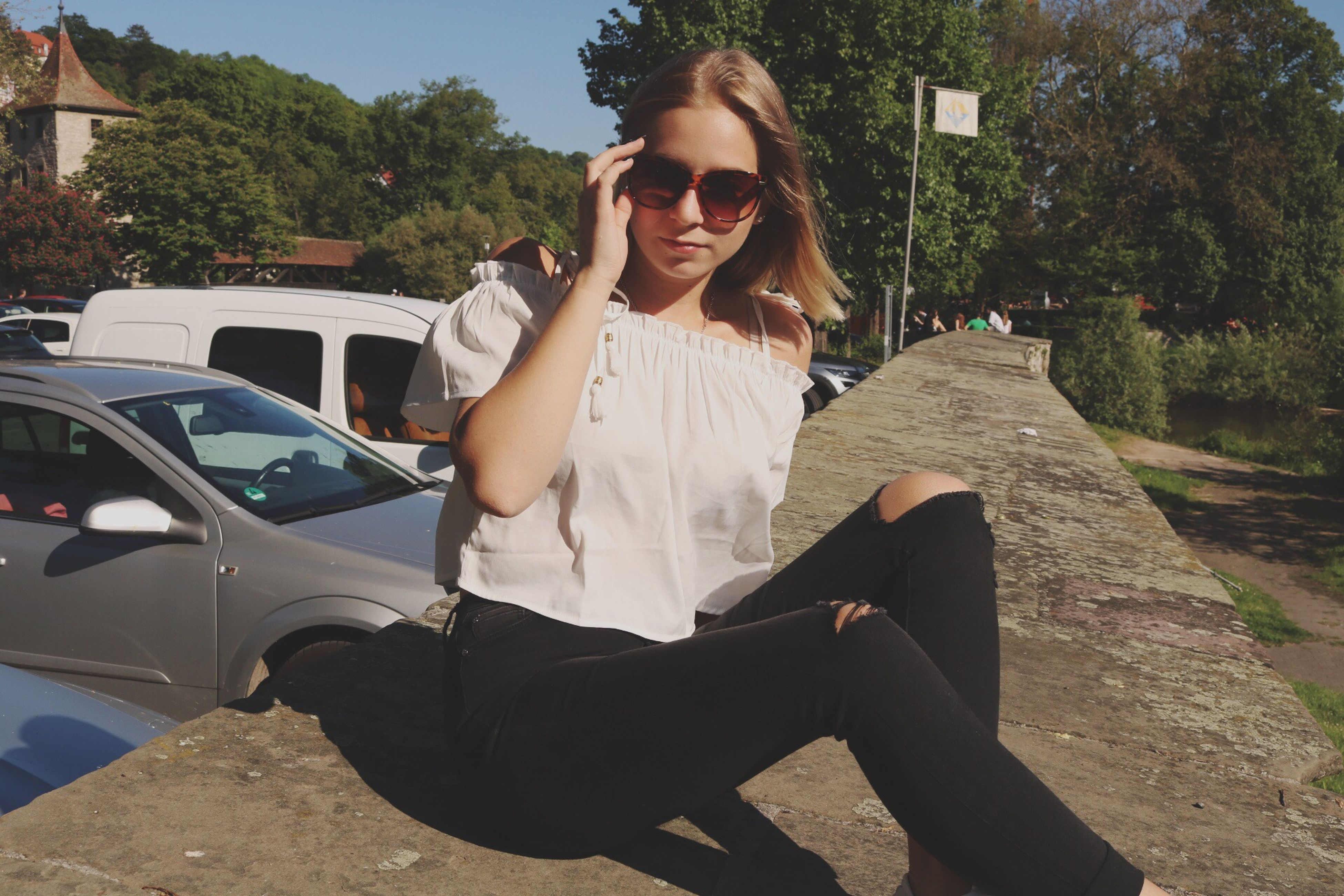 car, sunglasses, outdoors, young adult, smiling, transportation, real people, young women, tree, day, one person, people