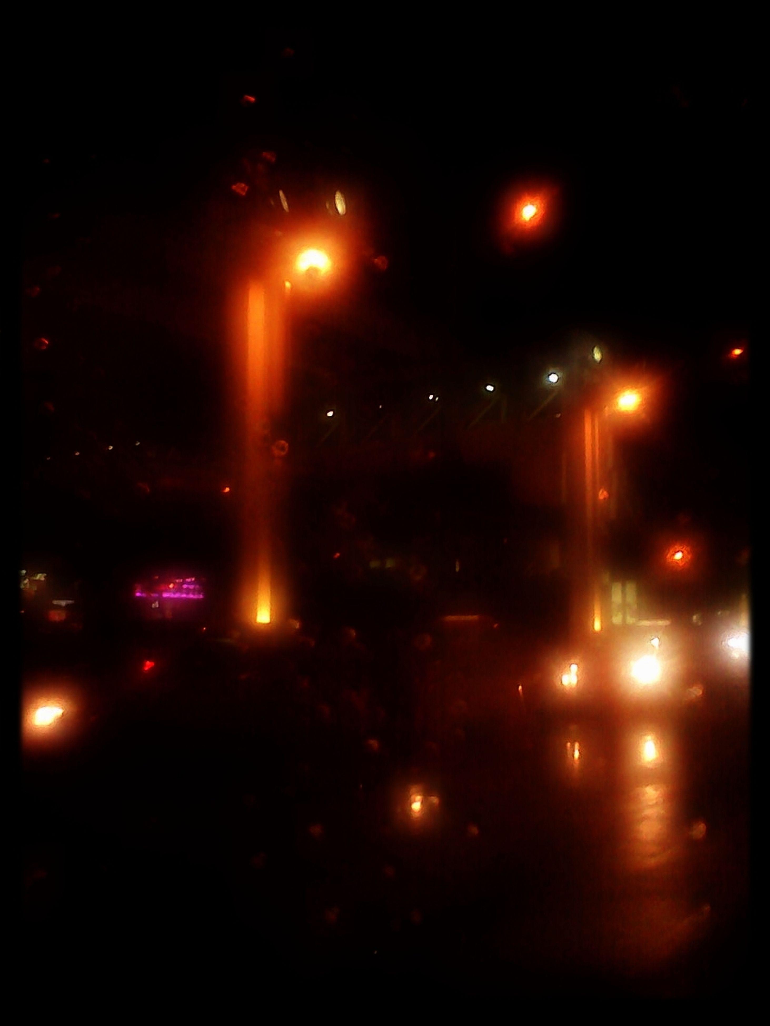 illuminated, night, street light, transportation, car, street, lighting equipment, land vehicle, road, city, dark, sky, mode of transport, light - natural phenomenon, city street, traffic, long exposure, building exterior, motion, outdoors