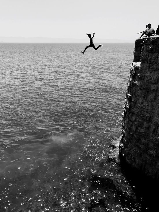 Free falling The Great Outdoors - 2017 EyeEm Awards Sea Water Flying Mid-air Nature Day Bird Horizon Over Water Outdoors No People Beauty In Nature Spread Wings Sky Shotoniphone7plus IPhone7Plus מייאייפון7 מייעכו מיישחורלבן Neighborhood Map Live For The Story Black And White Friday
