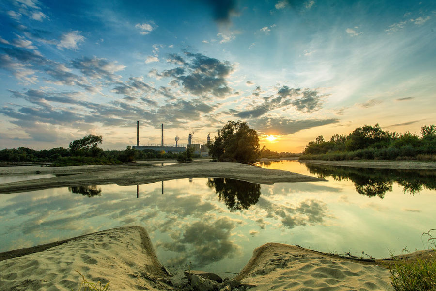 Power Stations Beauty In Nature Calm Cloud Cloud - Sky Idyllic Lake Lakeshore Landscape Majestic Nature No People Non Urban Scene Orange Color Outdoors Reflection Scenics Sky Standing Water Sun Sunset Tranquil Scene Tranquility Tree Water