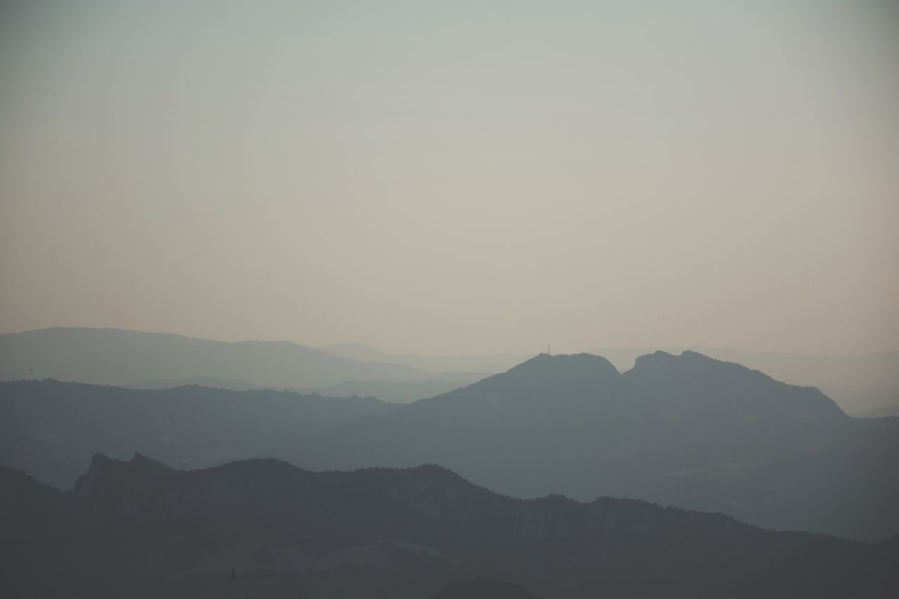 mountain, nature, beauty in nature, tranquil scene, tranquility, silhouette, mountain range, scenics, no people, outdoors, clear sky, landscape, sky, day