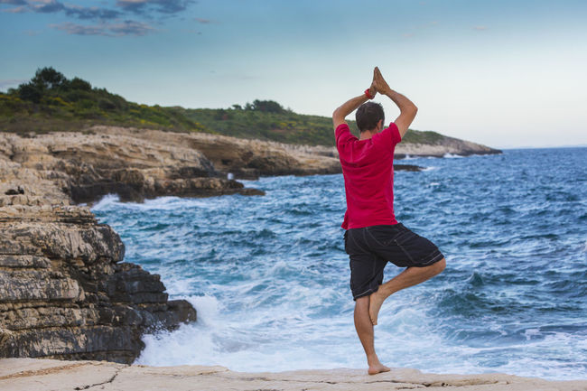 Activity Asana Attentiveness Calm Croatia Croatian Humility Istra Istria Kamenjak Kap Lifestyle Man Meditation Mediterranean  Mindful Peaceful Pose Recreation  Rocks Seaside Sports Tranquility Water Yoga